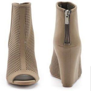 Juicy Couture tan peep toe bootie heels.